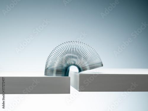 Cuadros en Lienzo Metal slinky spanning space between blocks
