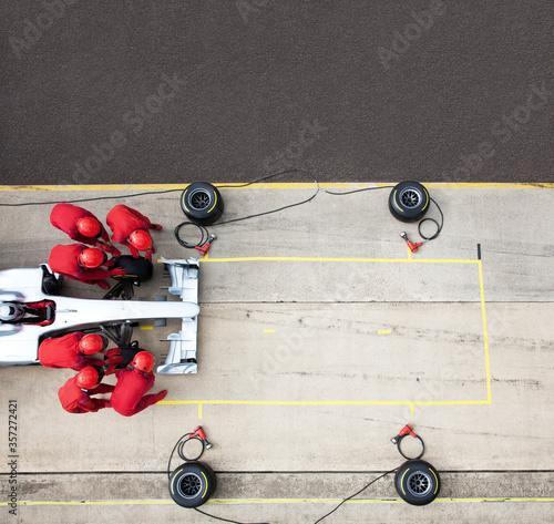 Racing team working at pit stop Wallpaper Mural