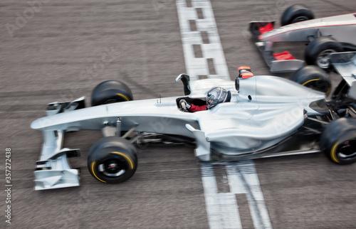 Fotografie, Obraz Race car crossing finish line on track