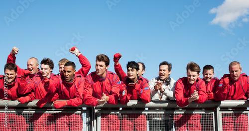 Fotografija Racing team cheering on sidelines