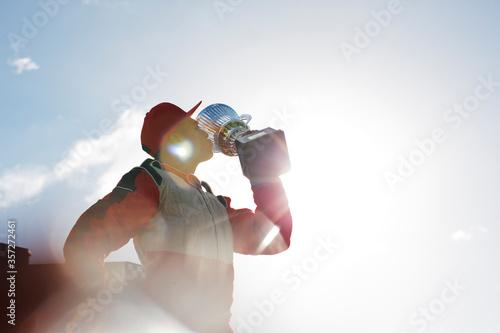 Fotografie, Obraz Racer kissing trophy on track