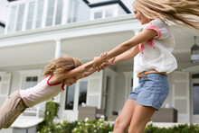 Mother And Daughter Playing Ou...
