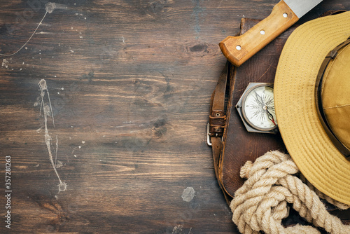 Old travel equipment on wooden table background with copy space. Fotobehang