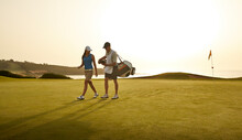 Caddy And Woman Walking On Gol...