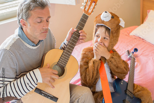 Obraz na plátne Father and son playing guitar together