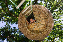 Woman Smiling In Modern Treehouse