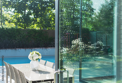 Photo Table and chairs by swimming pool