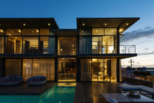 Luxury House With Swimming Pool Illuminated At Night
