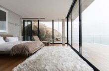 Shag Rug And Glass Walls In Modern Bedroom
