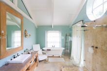 Bathtub And Shower In Rustic Bathroom