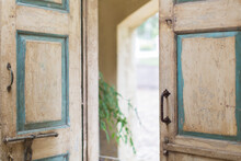 Close Up Of Door And Handles Of Rustic House
