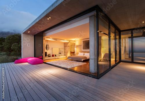 Fototapeta Sliding glass doors onto bedroom of modern house obraz