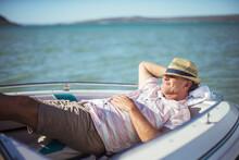 Older Man Relaxing In Boat On ...