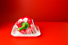 Close Up Of Bell Pepper Shrink Wrapped In Plastic