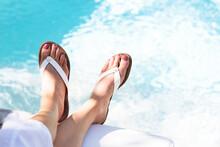 Close Up Of Woman's Feet Dangl...