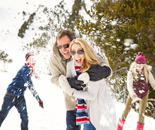 Family Having A Snowball Fight In The Snow