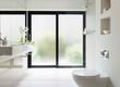 Leinwandbild Motiv White clean modern bathroom with frosted glass door