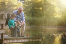 Grandfather And Grandson Readi...