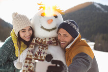 Couple Taking Selfie With Snow...