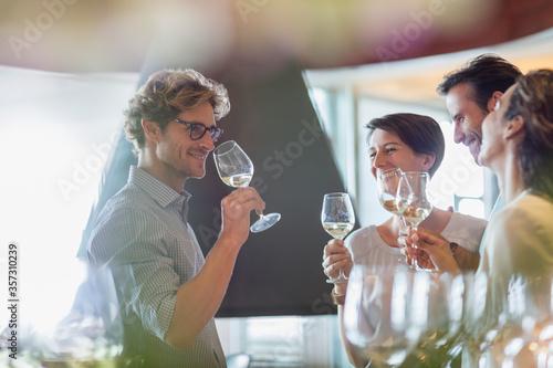 Photo Friends wine tasting in winery tasting room