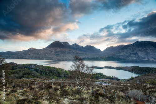 Photo Scenic view clouds over calm mountains lake, Russel Burn, Applecross, Scotland