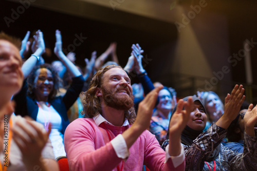 Smiling, enthusiastic man clapping in audience Canvas