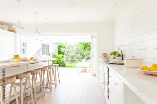 Simple white home showcase interior kitchen open to patio Wallpaper Mural