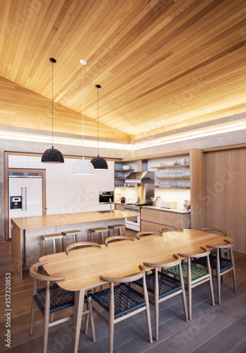 Photo Illuminated slanted wood ceiling over kitchen