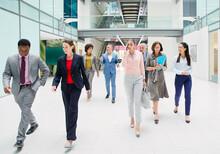 Business People Walking In Mod...