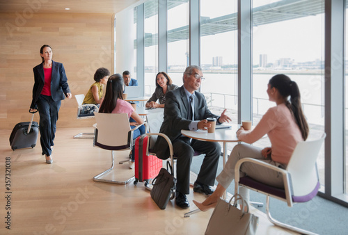 Business people working and talking in airport business lounge Canvas Print