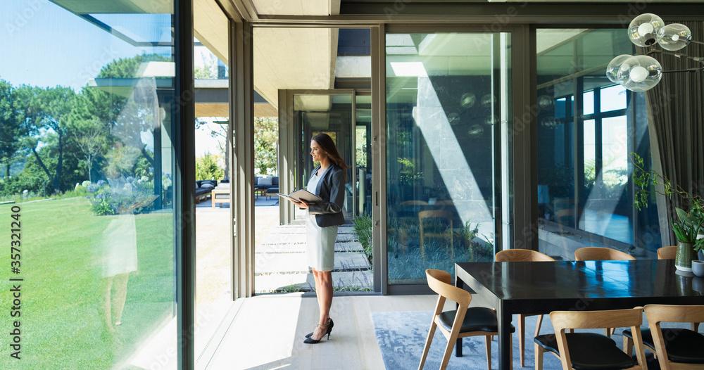 Fototapeta Confident businesswoman working from home, standing in corridor