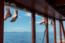 Bare Feet Dangling Over Sunny ...