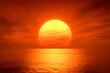 Leinwandbild Motiv light sunset orange sun calm orange sea with sun through nature horizon over the water with a cloudy sky.