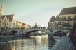 canvas print picture - Mesmerizing view of the bridge over the water canal and historical buildings in Ghent, Belgium