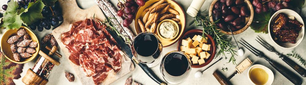 Fototapeta Wine and tapas, top view