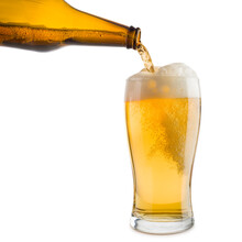 Pouring Blonde Beer Into Glass, Isolated On White Background