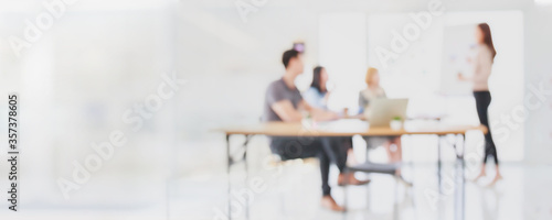 Abstract blurred interior modern office space with business people group working banner background with copy space.