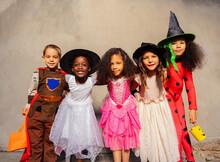 Group Of Kids In Halloween Cos...
