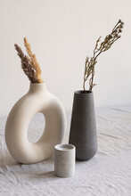 Two Ceramic Handmade Vases With Dried Wildflowers And Spikes And Aromatic Candle