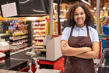 Young Smiling Shop Assistant O...