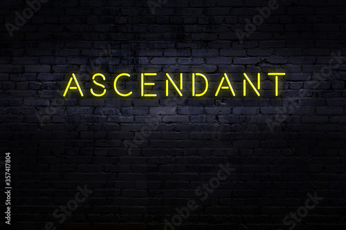 Photo Night view of neon sign on brick wall with inscription ascendant