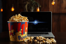 Popcorn In Bowl And Laptop Pla...