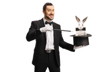 Magician Pulling A Rabbit From A Hat With A Wand