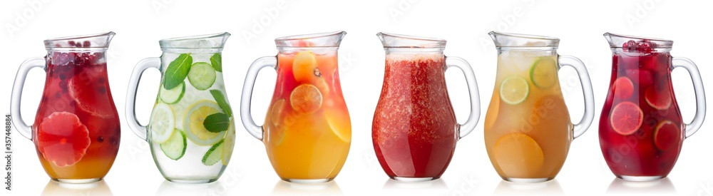 Fototapeta Iced beverages and cocktails in glass pitchers isolated w clipping paths