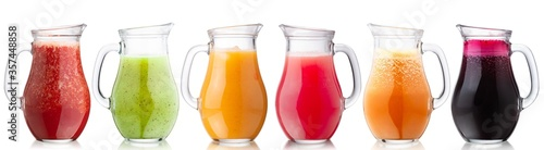 Fotografie, Obraz Smoothies of freshly pressed juices in glass pitchers, isolated w clipping paths