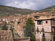 Buildings Of The Village Over The Mountains Under The Clouded Sky