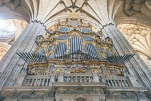 Low Angle Shot Of The Salamanca Cathedral Organ Covered In Paintings Under The Lights In Spain