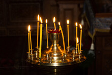 Candles And Orthodox Crucifix.