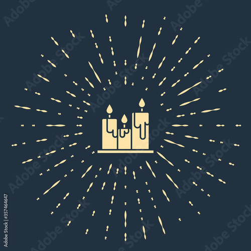 Beige Burning candles icon isolated on blue background Wallpaper Mural
