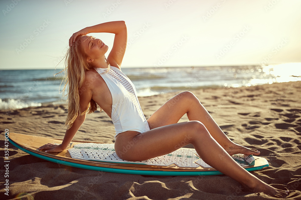 Fototapeta Sexy woman at swimsuit on the beach.Surfer girl.